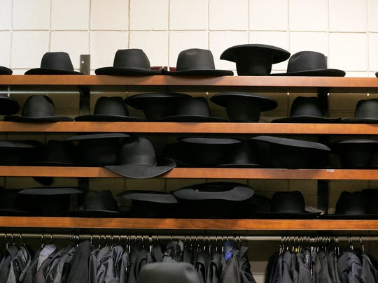 Black hats fill the shelves inside a coatroom at Israel Henry Beren Hall at Beth Medrash Govoha in Lakewood, NJ Wednesday, February 7, 2018.
