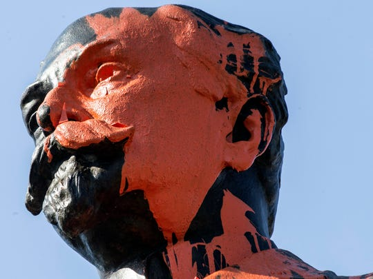 The face of the John Castleman statue seemed to have suffered a direct hit from orange paint sometime on Thursday morning as the Highlands landmark was vandalized for the second time since February. 4/12/18