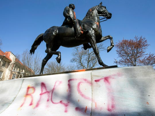 The word racist was painted on the east facing side of the Castleman statue in the Cherokee Triangle in April 2018.