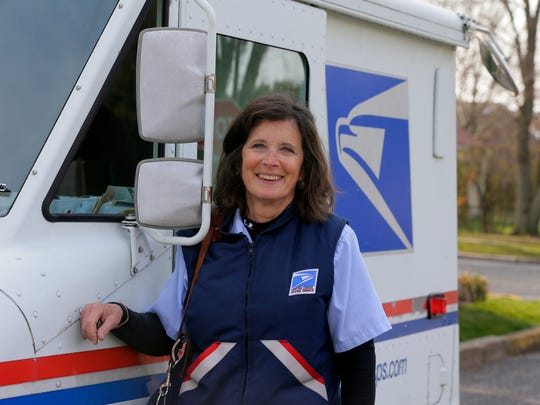 Robin O'Neill, of Brick, a mail carrier in Spring Lake and Spring Lake Heights who is being honored for driving accident-free for 30 years, starts her mail route in Spring Lake Heights, NJ Thursday April 12, 2018.