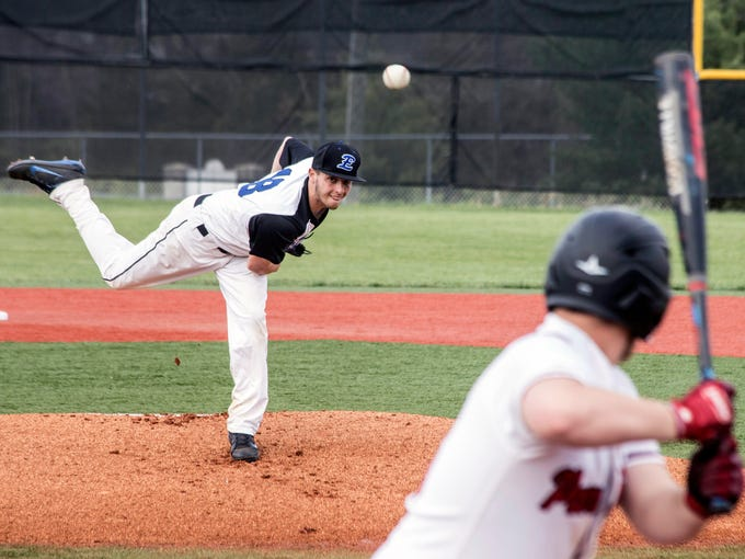 Eastern High's Chase Thomas throws out an early pitch