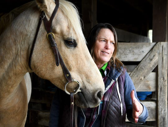 Judy Sutton, head wrangler at Cataloochee Ranch, stands