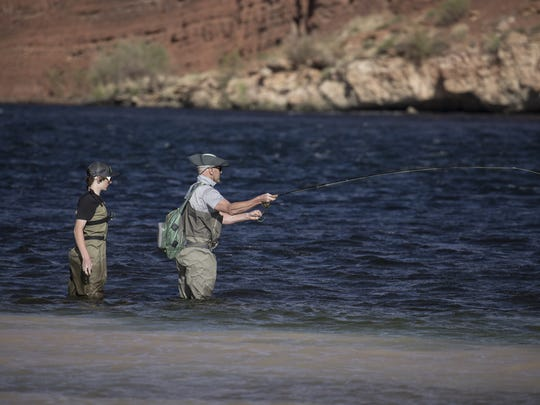 Micah Utterback (right) teaches his son, Josh Utterback (14, both from Payson) how to fly fish for rainbow trout, April 12, 2018, on the Colorado River at Lees Ferry, Glen Canyon National Recreation Area.