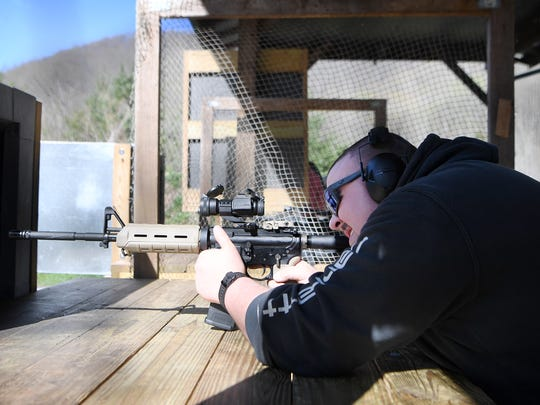 Javier Moraga fires an AR-15 at the Wayne E. Smith Cold Mountain Shooting Range in Haywood County on Friday, April 27, 2018.