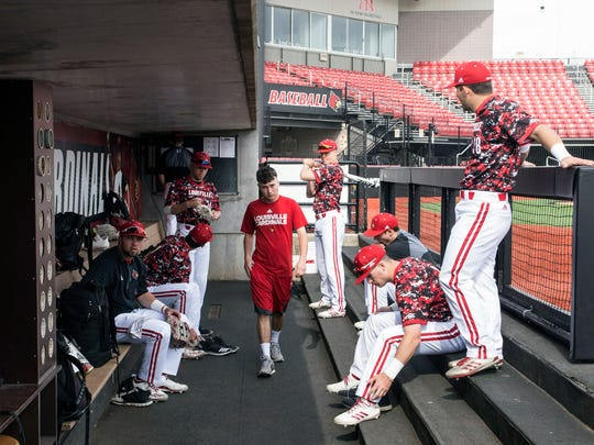 Players gather in the dugout during pregame warm ups heading into a Sunday matchup against Virginia. 4/22/18