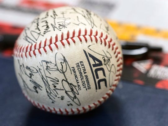 Louisville baseball players were asked to sign a ball