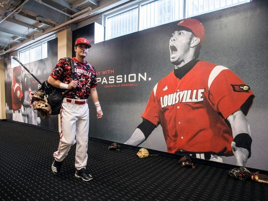 Louisville infielder Tyler Fitzgerald gathers his gear before another morning meeting as the baseball team prepares to play Virginia at Jim Patterson Stadium. 4/22/18