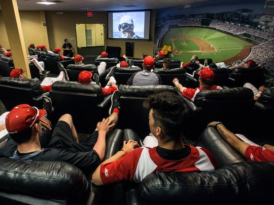 Louisville's baseball team streams YouTube videos on the big screen as a way to relax before a game. 4/22/18