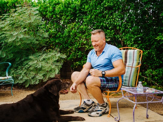 Jeff Hocker and his chocolate lab, Chelsea, in Palm Springs