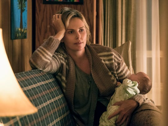 """Marlo (Charlize Theron) is unapologetically stuck in a funk after the birth of her third child in """"Tully."""""""