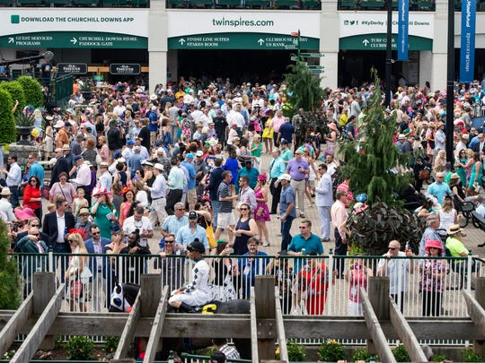 The crowds began to swell early at Churchill Downs