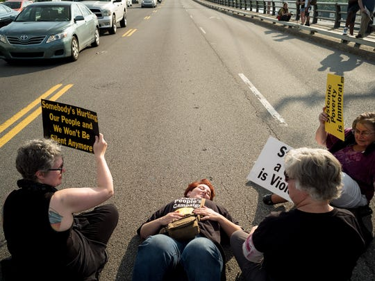 Beth Foster, center, of Chattanooga, and other protesters