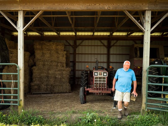 Bob Strasser works at his farm, Tuesday, May 15, 2018,