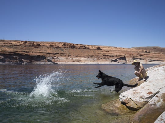 Kathleen Weldon (left) dives into Lake Powell at the
