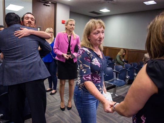 Family members of Brandon Phelps hug prosecutors Wednesday, May 16, 2018, in the 214th District Court after Jason Auvenshine was sentenced to life on two counts in the death of Phelps, a 20-year-old skateboarder killed in a hit-and-run in Port Aransas.