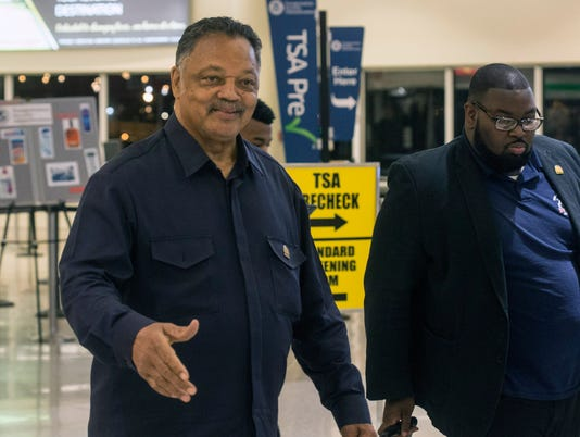 Rev. Jesse Jackson greets fans at Louisville International Airport