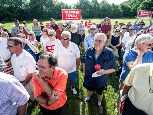 A group called Louisville Neighbors for Responsible Growth held a rally