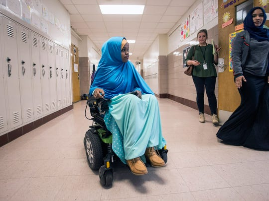 Fardowsa Sharif uses a wheelchair to navigate the long-hall design of Iroquois High School in her final days as a student. 5/24/18