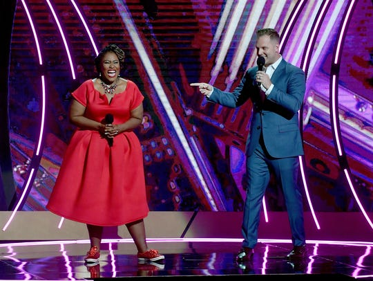 Hosts Mandisa, left, and Matthew West perform onstage