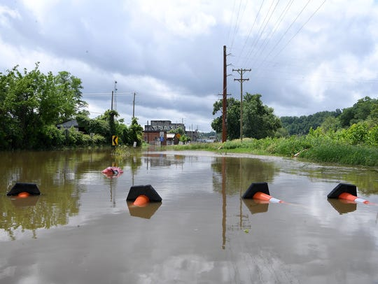 The French Broad River floods into Lyman Street in