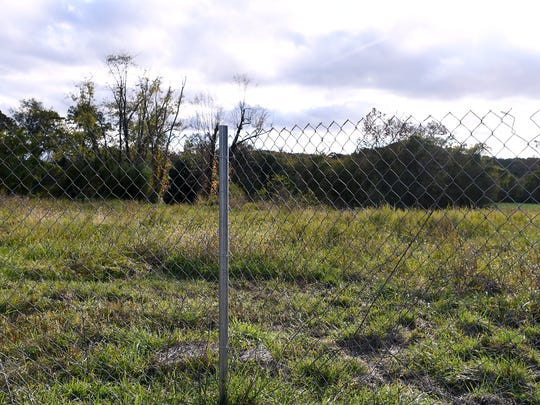 A fence surrounds the Karen Cragnolin River Park on Amboy Road on Wednesday, Oct. 25, 2017. After signing a Brownfield Agreement for the property, RiverLink removed and recycled 100,000 tons of concrete from the site.