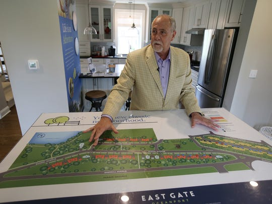 """David J. Schoner, Northeast vice president of Coldwell Banker NewHomes, tours East Gate, which will soon become a neighborhood of 68 restored officer's homes at Fort Monmouth, in Oceanport, NJ Wednesday May 30, 2018. Coldwell Banker NewHomes in Florham Park is the """"builder representative"""" for East Gate."""