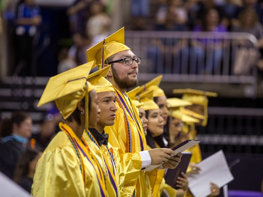 "Ezequiel ""Zeke"" Cuestas (center) prepares to graduate from Miller High School on Friday, June, 1 2018 at the American Bank Center. He was told he wouldn't be able to walk the stage to graduate due to Leukemia, but went to physical therapy twice a week to be strong enough to walk the stage. He is currently in remission."