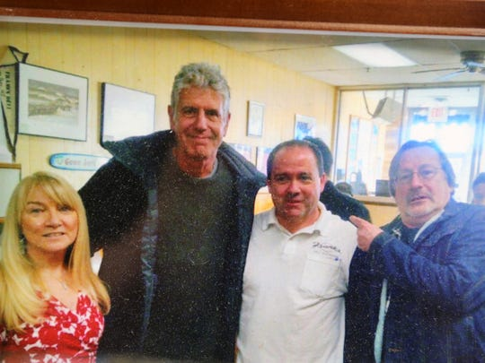 Joe Maggio, owner of Frank's Deli, talks about Anthony Bourdain's 2015 visit to Frank's Deli in Asbury Park, NJ Friday June 8, 2018. The picture shows his wife, Mary, Anthony Bourdain, himself and Southside Johnny.
