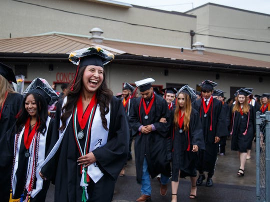 Graduates walk onto the field for the North Salem High School commencement at the North Salem High School Stadium on Friday, June 8, 2018. SHANNON MILLARD / Special to the Statesman Journal