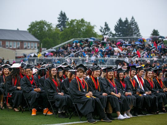 Graduates during the North Salem High School commencement at the North Salem High School Stadium on Friday, June 8, 2018. SHANNON MILLARD / Special to the Statesman Journal