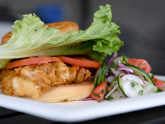 The fried chicken at The Burger Stop is buttermilk brined and hand breaded. The pictured cucumber salad is one of the rotating veggies of the day that can be chosen as a side.