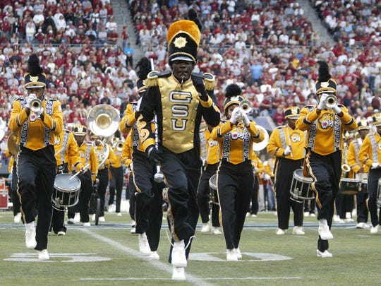 """Grambling State drum major Earl Henry leads the Mighty Tigers band during the half time show in 2005. This photo is featured in the touring Smithsonian exhibit """"Hometown Teams: Sports in American Communities."""""""