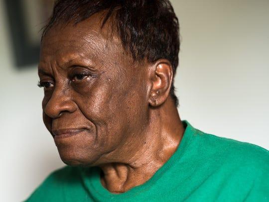 Lillian Williams speaks with members of Rebuilding