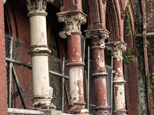 The style of Quinn Chapel, designed by Louisville architect Henry Wolters in 1884, draws mostly from the Gothic revival era.
