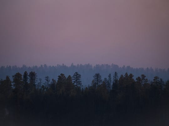 Smoke from the Tinder Fire darkens the sky over the Coconino National Forest in May 2018.