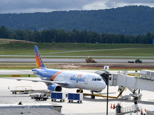 An Allegiant Airlines plane waits at a gate at the
