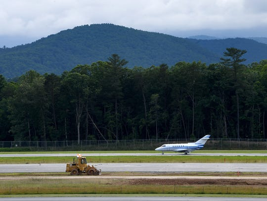 A plane on the runway at the Asheville Regional Airport
