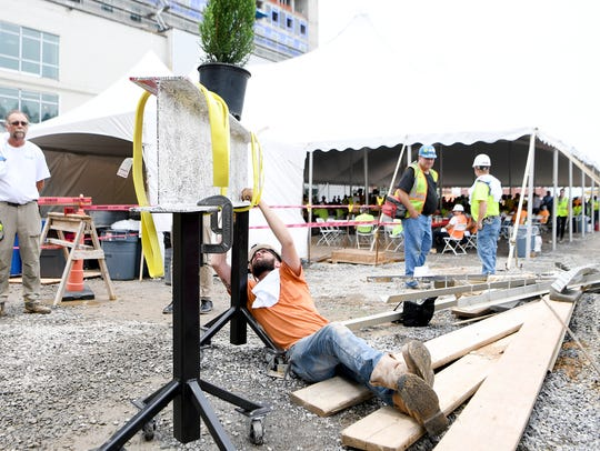 Construction worker Trevon Holmes finds a spot to sign