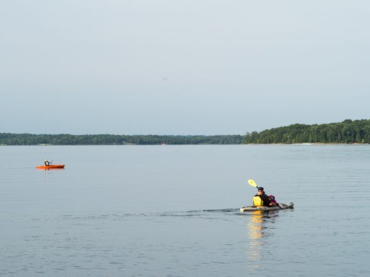 Kayakers paddle on Percy Priest Lake in Nashville,