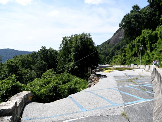A collapsed retaining wall in the upper parking lot