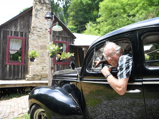 Tom Hare sits inside his 1940 Ford Coupe that he purchased
