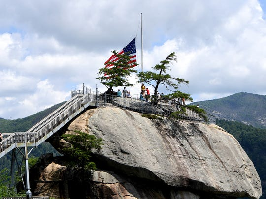 Visitors take in the view of Lake Lure from Chimney