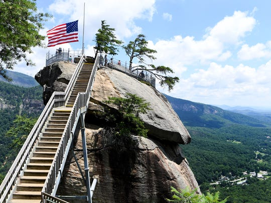 Visitors take in the view at Chimney Rock State Park