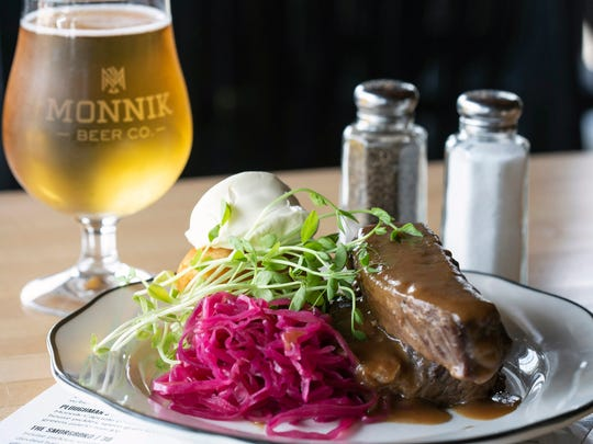The sauerbraten at Monnik Beer Company is sour beef pot roast, pickled red cabbage, potato dumpling, gingersnap sauce, and creme fraiche. 7/2/18