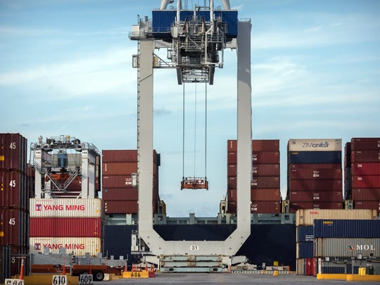 "In this Thursday, July, 5, 2018 photo, a ship to shore crane prepares to load a 40-foot shipping container onto a container ship at the Port of Savannah in Savannah, Ga. The United States and China launched what Beijing called the ""biggest trade war in economic history"" Friday, July 6, imposing tariffs on billions of dollars of each other's goods amid a spiraling dispute over technology."
