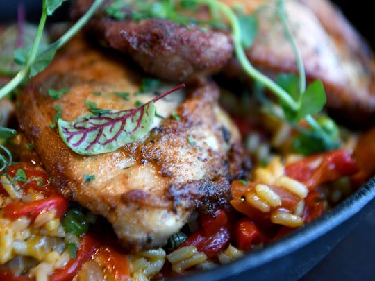 The Arroz Con Pollo at Hemingway's Cuba is yellow rice, roasted chicken, sweet peas and red roasted peppers.