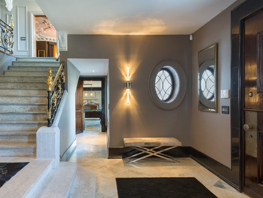 The entry foyer features the home original, 600 pound