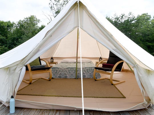 The glamping tents at Paint Rock Farm in Hot Springs are all equipped with a queen-sized memory foam mattress, bedside tables, battery-powered lamps, chairs and a rug to make sleeping outside as comfortable as possible.