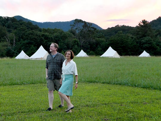 Dale and Jennifer Gonzalez, of Atlanta, walk to the