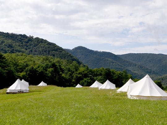 Bell tents on platforms are each surrounded with their